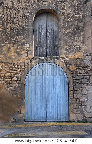 Closed door and window on old stone facade building