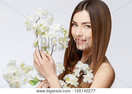 Beautiful Face of Young Woman with Clean Fresh Skin close up. Beauty Portrait. Beautiful Spa Woman Smiling. Perfect Fresh Skin. Pure Beauty Model. Youth and Skin Care Concept