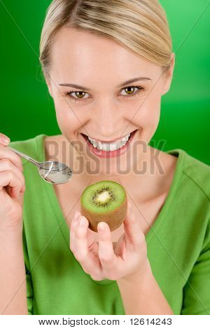 Healthy Lifestyle - Happy Woman Holding Kiwi On Green