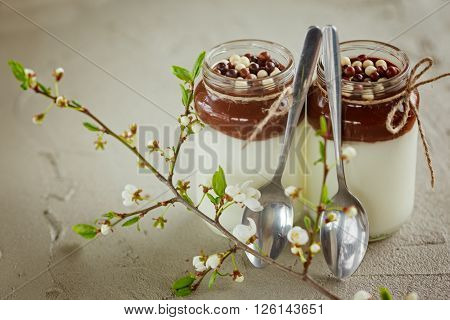 Homemade yogurt with chocolate mousse and  chocolate candy drops