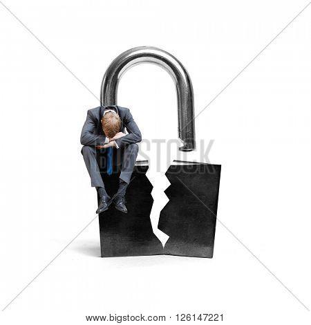 A businessman on a broken lock