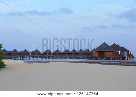 Exotic wooden water bungalows.