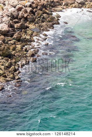 An Aqua Sea Against Rocks in Curacao