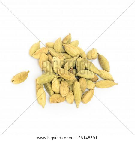 Closeup of cardamom pods isolated on white background