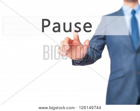 Pause - Businessman Hand Pressing Button On Touch Screen Interface.