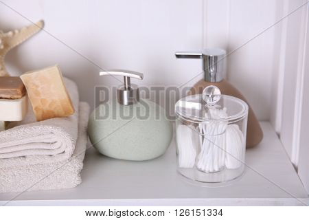 Bathroom set with towels, soap and starfish on a light shelf