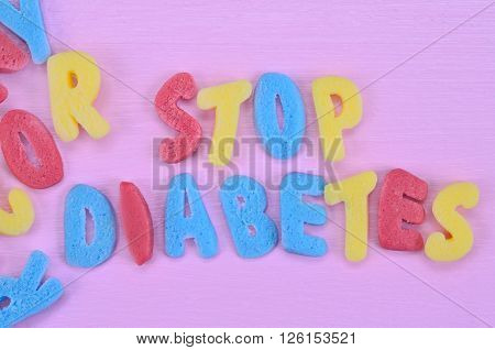 Stop Diabetes words on pink wooden table