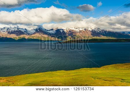 Mighty fjords with mountains covered by snow near Olafsfjordur, Northern Iceland