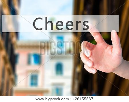 Cheers - Hand Pressing A Button On Blurred Background Concept On Visual Screen.