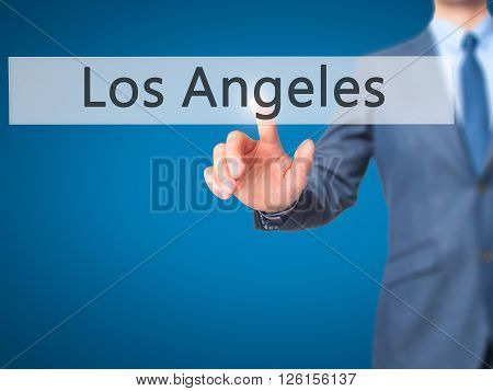 Los Angeles - Businessman Hand Pressing Button On Touch Screen Interface.