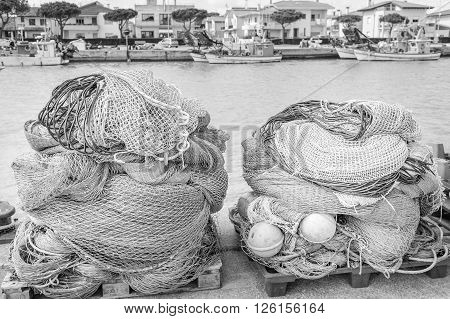 Fishing nets fishing boats in the background