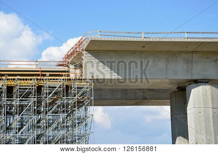Highway building process: building of carriageway over land on pillars