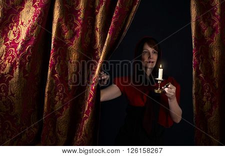 Portrait of middle age woman with candlestick