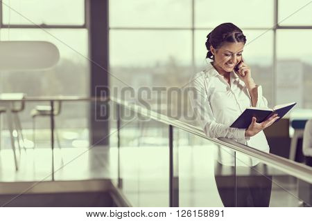 Young successful business woman speaking on a mobile phone