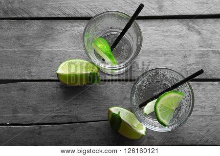 Glasses of lemon soda on rustic wooden table