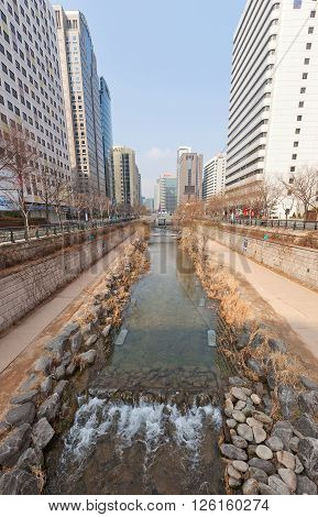 SEOUL SOUTH KOREA - MARCH 14 2016: Cheonggyecheon stream in Seoul Korea. Cheonggyecheon is a 11 km long modern (since 2005) public recreation space in downtown Seoul on the site of a stream