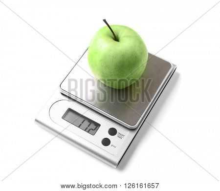 Apple on digital kitchen scales, isolated on white