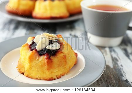 Tea with cakes on wooden background