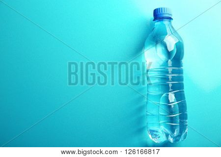 Bottled water on the blue background, top view