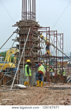 MALACCA, MALAYSIA - SEPTEMBER 03, 2015: Column form work made from timber and plywood fabricated at the construction site by workers.