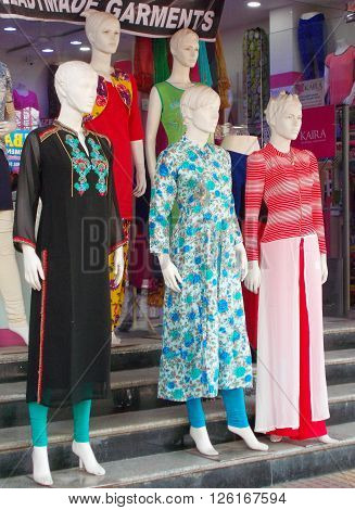 HYDERABAD,INDIA-MARCH 23: .Mannequins dressed in latest Indian fashion dress in front of clothes store on March 23,2016 in Hyderabad,India