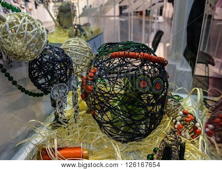 Exhibit Showcases collection of handmade jewelry. On rounded womb of threads and ropes hooked decorations which create a feminine image. fashion show. 18 March 2016. Kyiv Ukraine