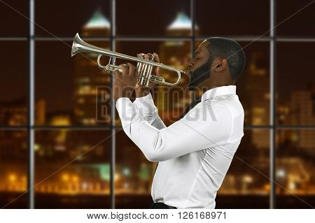 Afro trumpeter playing music. Musician with trumpet at night. Performing hits of past century. Special guest in concert hall.