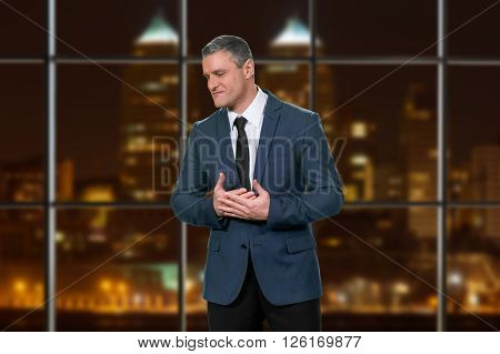 Stressful adult businessman wearing suit. Nervous executive on night background. Calm yourself down. New job new stress.