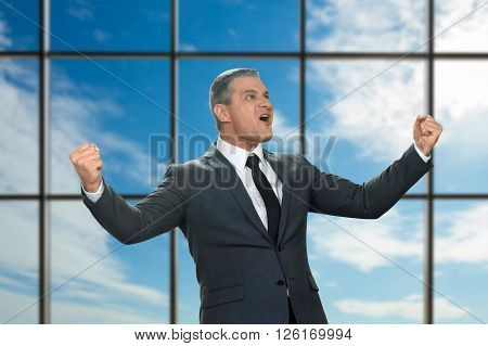 Adult emotional businessman in suit. Victorious man on sky background. I proved my theory. It's a jackpot, gentlemen.