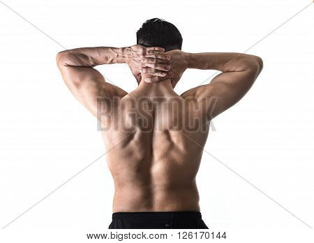 back of young muscular sport man holding sore neck with his hands and touching or massaging cervical area suffering body pain in spine and back health problem isolated on white background