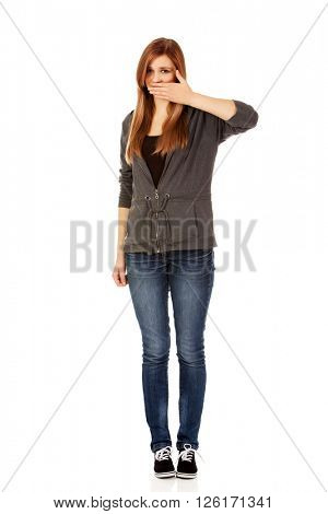 Teen woman covering her mouth with hand