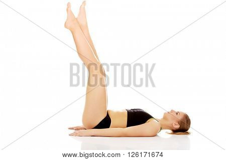 Fitness woman with her legs up practising yoga