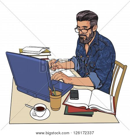 A hipster man in a jeans jacket sits at a table. Writer, journalist, scholar, student write his work in the computer. Work on the Internet. On the table, a lot paperwork. The process of study.