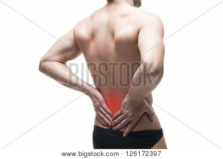 Man with backache. Pain in the human body. Muscular male body. Isolated on white background with red dot