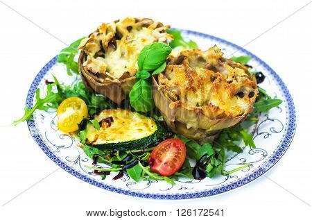 Stuffed and gratinated artichokes isolated on white background