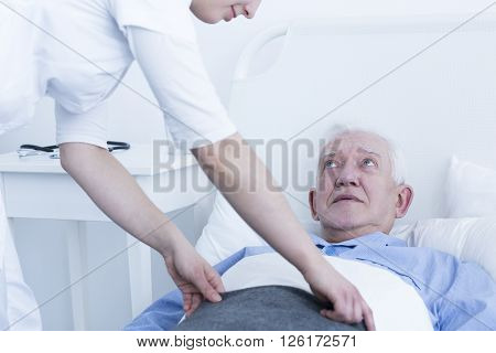 Shot of a young nurse and her patient laying on a bed