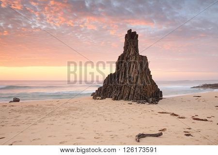 Beach seascape from Meringo Eurobodalla National park with magnificent shaped sea stack pointing to that awesome sunrise sky ** Note: Soft Focus at 100%, best at smaller sizes