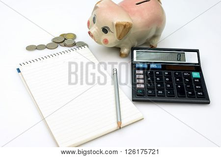 Piggy bank notes and calculator on a white background, concept of savings