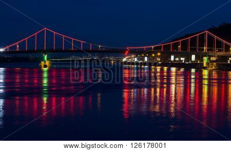 Lights Night City And Bridge With Reflections On The River