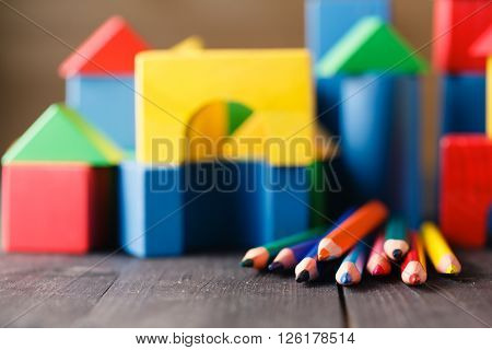 Different Colors Of Pencils Ontable With Building Blocks