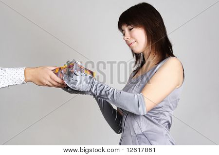 Beauty Woman In Evening Dress And Gloves Taking Gift From Mans Hand And Smiling