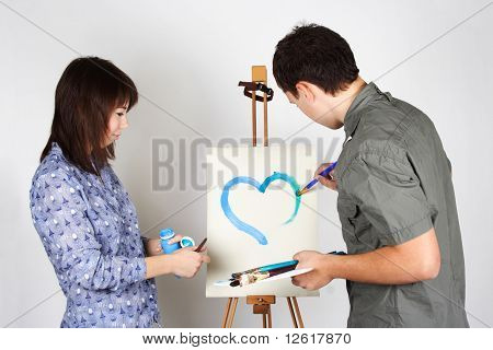 Man And Girl Holding Brushes And Palette, Painting Blue Heart