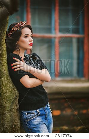 Beautiful fashionable woman standing on the city street.