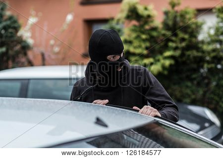 Car Thief Entering The Vehicle And Stealing A Car.