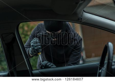 Car Thief Trying To Break Into The Car