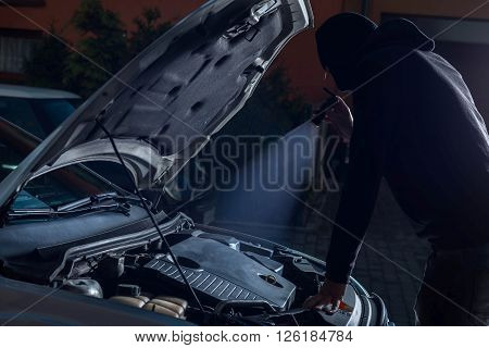 Car Thief With Flashlight Disarming Car Protections