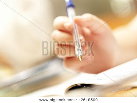 Hand Of The Person Holds Pen