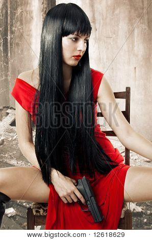 Sexy Brunette Woman In Red Dress With Weapon