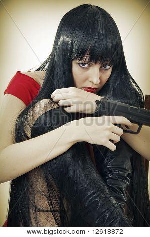 Scared Woman With Handgun