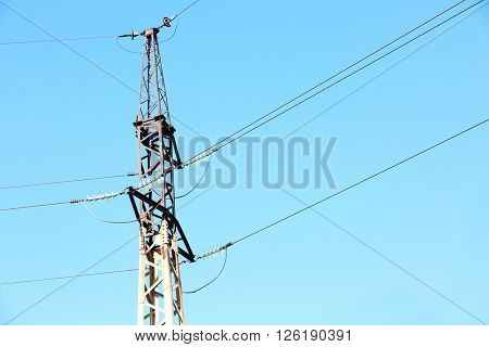 Electric pole over blue sky background